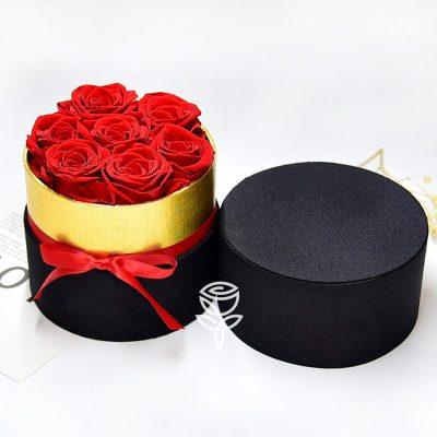 Caja Redonda de 7 Rosas Rojas Preservadas